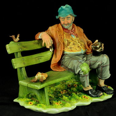 clown on a bench by capodimonte